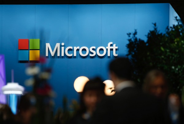 A logo sits on display outside the Microsoft Corp. pavilion at the Mobile World Congress in Barcelona, Spain, on Wednesday, March 4, 2015. The event, which generates several hundred million euros in revenue for the city of Barcelona each year, also means the world for a week turns its attention back to Europe for the latest in technology, despite a lagging ecosystem. Photographer: Simon Dawson/Bloomberg