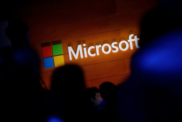 NEW YORK, NY - MAY 2: The Microsoft logo is illuminated on a wall during a Microsoft launch event to introduce the new Microsoft Surface laptop and Windows 10 S operating system, May 2, 2017 in New York City. The Windows 10 S operating system is geared toward the education market and is Microsoft's answer to Google's Chrome OS. (Photo by Drew Angerer/Getty Images)