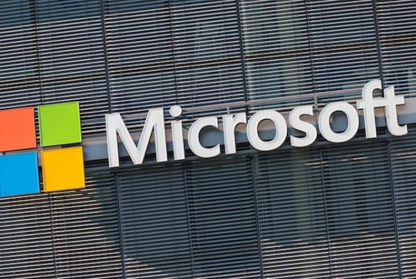 COLOGNE, GERMANY OCTOBER, 2017: Microsoft logo on a wall. Microsoft is an international corporation that develops, supports and sells computer software and services worldwide.
