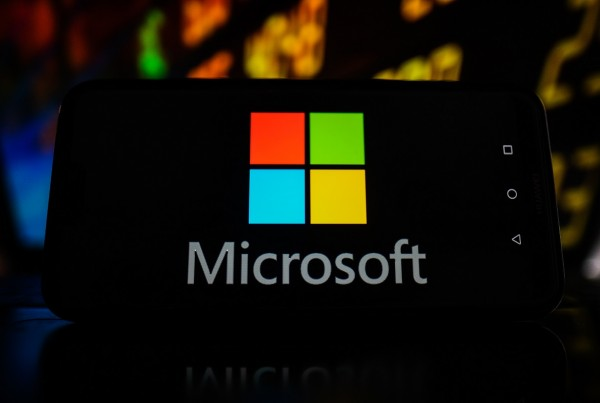 POLAND - 2021/02/19: In this photo illustration a Microsoft logo seen displayed on a smartphone with stock market values in the background. (Photo Illustration by Omar Marques/SOPA Images/LightRocket via Getty Images)